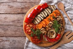 Grilled vegetables on a chopping board horizontal top view Royalty Free Stock Image