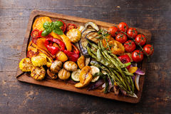 Grilled vegetables on cutting board Royalty Free Stock Photos
