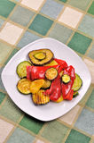 Grilled vegetables on dining table Stock Photos