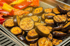 Grilled vegetables. Eggplant and bulgarian pepper. Grilled vegetables on a grill. Kitchen Royalty Free Stock Image