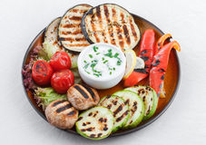Grilled vegetables with garlic dip. Stock Photo