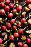 Grilled vegetables, grilled radish skewers with herbs and spices on a grill plate, top view,. Close-up. Vegetarian food stock photo