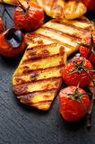Grilled vegetables with halloumi cheese on a black background Stock Photography