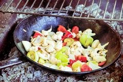 Grilled vegetables inside of a grill pan Stock Photos
