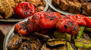Grilled vegetables with meat. Grilled vegetables with grilled meat at the background Stock Images