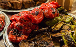 Grilled vegetables with meat. Grilled vegetables with grilled meat at the background Stock Image