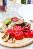 Grilled vegetables and mushroom with sauce on a wooden board Stock Photos