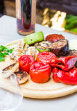 Grilled vegetables and mushroom with sauce on a wooden board Stock Images