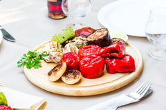 Grilled vegetables and mushroom with sauce on a wooden board Royalty Free Stock Photos