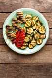 Grilled vegetables and mushrooms. Grilled zucchini, eggplant, sweet pepper and mushrooms on plate. Stock photo Stock Image