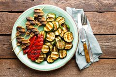 Grilled vegetables and mushrooms. Grilled zucchini, eggplant, sweet pepper and mushrooms on plate. Stock photo Royalty Free Stock Photos