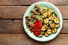 Grilled vegetables and mushrooms. Grilled zucchini, eggplant, sweet pepper and mushrooms on plate. Stock photo Royalty Free Stock Photography