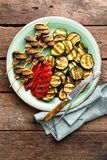 Grilled vegetables and mushrooms. Grilled zucchini, eggplant, sweet pepper and mushrooms on plate. Stock photo Royalty Free Stock Image