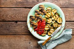 Grilled vegetables and mushrooms. Grilled zucchini, eggplant, sweet pepper and mushrooms on plate. Stock photo Stock Images