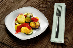 Grilled vegetables on a old wooden table Stock Photo