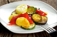 Grilled vegetables on a old wooden table Stock Image