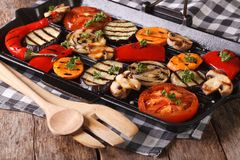 Grilled vegetables: peppers, tomato, onion,  in pan grill Stock Photos