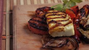 Grilled vegetables on a plate stock video