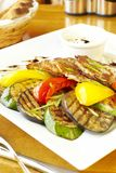 Grilled vegetables and potato fritters Stock Images