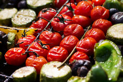 Grilled vegetables prepared outdoors. Tasty vegetables prepared on a grill, picnic in summer outdoors Royalty Free Stock Photos