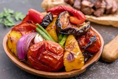 Grilled vegetables salad with eggplant, onions, peppers, asparagus, tomato Stock Photos