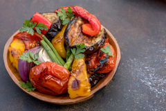Grilled vegetables salad with eggplant, onions, peppers, asparagus and tomato. Grilled vegetables salad with eggplant, onions, peppers, asparagus, tomato and Royalty Free Stock Photography