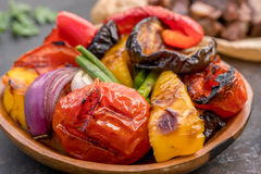 Grilled vegetables salad with eggplant, onions, peppers, asparagus and tomato. Grilled vegetables salad with eggplant, onions, peppers, asparagus, tomato and Stock Photos