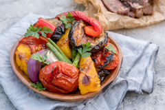 Grilled vegetables salad with eggplant, onions, peppers, asparagus and tomato. Grilled vegetables salad with eggplant, onions, peppers, asparagus, tomato and Stock Image