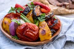 Grilled vegetables salad with eggplant, onions, peppers, asparagus, tomato. And herbs Stock Photo