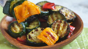 Grilled vegetables salad with zucchini, eggplant, onions, peppers and herbs stock footage