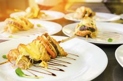Grilled vegetables skewers with cheese. On plate. Close up Stock Image