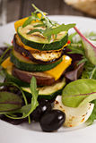 Grilled vegetables stacked on plate Stock Photo