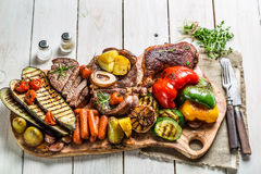 Grilled vegetables and steak with herbs Royalty Free Stock Photos