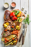 Grilled vegetables and steak with salt on wooden board Stock Images