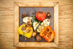 Grilled vegetables on a stone board. Grilled vegetables. Tomato, zucchini paprika and potatoes stock image