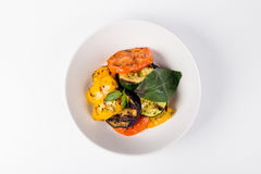 Grilled vegetables with tomatoes and eggplant in white plate Royalty Free Stock Photo