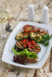 Grilled vegetables on white plate Stock Photos