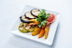 Grilled vegetables on white square plate. Royalty Free Stock Images