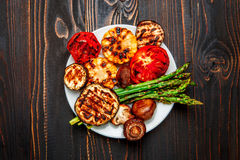 Grilled vegetables on wooden table Stock Image