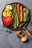 Grilled vegetables zucchini, asparagus, bell pepper, sausages on grill pan Stock Photography