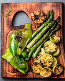 Grilled vegetables zucchini, asparagus, bell pepper, sausages on grill pan Stock Photo