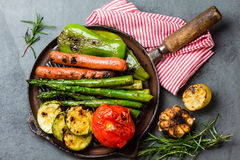 Grilled vegetables zucchini, asparagus, bell pepper, sausages on grill pan Royalty Free Stock Image
