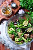 Grilled vegetables - zucchini, eggplant, green beans, onion, mushrooms, garlic and coriander, olive oil, wine vinegar and light so Stock Image