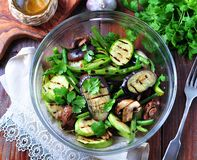 Grilled vegetables - zucchini, eggplant, green beans, onion, mushrooms, garlic and coriander, olive oil, wine vinegar and light so Stock Photos