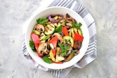 Grilled vegetables - zucchini, portobello mushrooms, red pepper, red onion, green onion, garlic, olive oil, wine vinegar, sea salt. And parsley. Healthy food stock photo