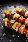 Grilled Vegetarian skewers with halloumi cheese and mixed vegetables. On black background Stock Photography