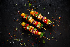 Grilled Vegetarian skewers with halloumi cheese and mixed vegetables. On black background, top view Stock Photo