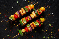 Grilled Vegetarian skewers with halloumi cheese and mixed vegetables royalty free stock image