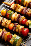 Grilled Vegetarian skewers with halloumi cheese and mixed vegetables stock images