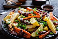 Grilled veggies on a rustic wooden board